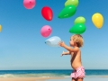 Child_with_Balloons_on_the_Beach
